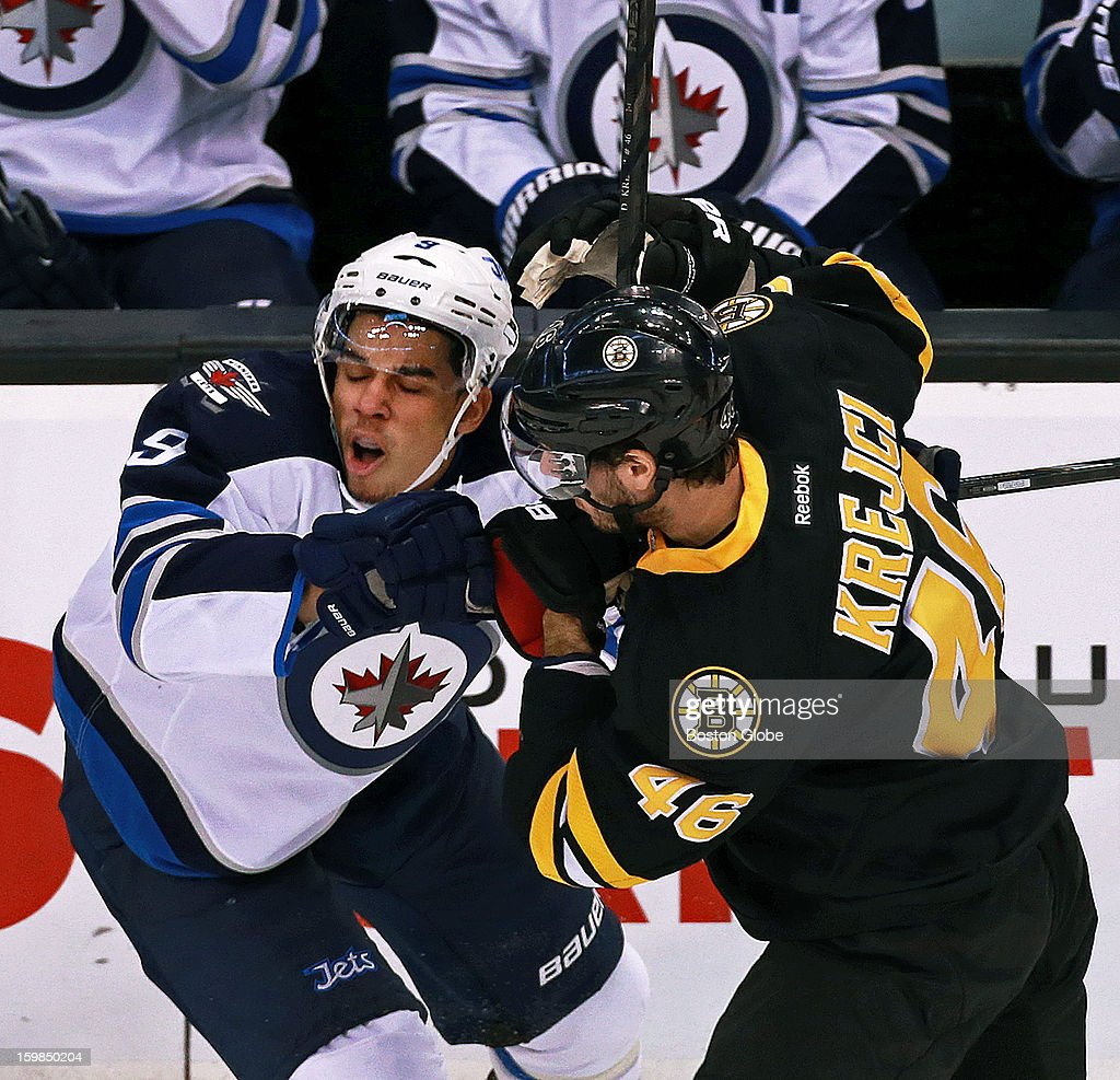 The Bruins' David Krejci, right, received a two minute penalty for high sticking for this second period hit on the Jets' Evander Kane, right, as the Boston Bruins hosted the Winnipeg Jets in an NHL regular season game at the TD Garden.