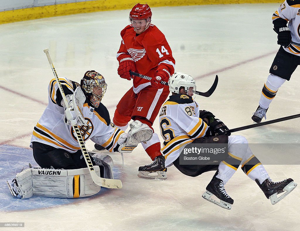 The Bruins' Kevan Miller sails in front of his goalie Tuukka Rask as the Red Wings Gustav Nyquist looks on, during third period action. The Boston Bruins visited the Detroit Red Wings for Game Three of their NHL Eastern Conference Quarterfinal Stanley Cup Playoff series at Joe Louis Arena on April 22, 2014.
