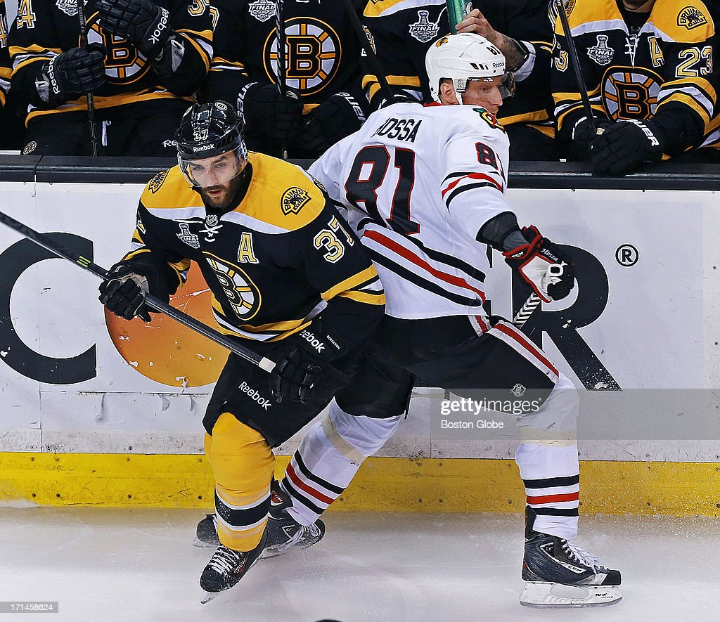 The Bruins Patrice Bergeron, left, battles with Chicago's Marian Hossa in the first period. The Boston Bruins hosted the Chicago Blackhawks for Game Six of the Stanley Cup Finals at TD Garden, June 24, 2013.