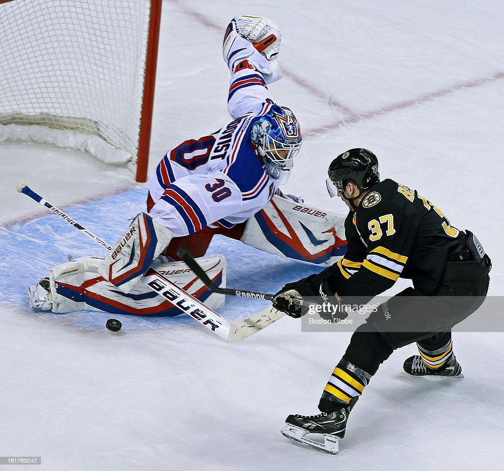 The Bruins' Patrice Bergeron walked in all alone on Rangers goalie Henrik Lundqvist late in the second period, but the New York net minder turned him away. The Boston Bruins hosted the New York Rangers in an NHL regular season hockey game at the TD Garden.