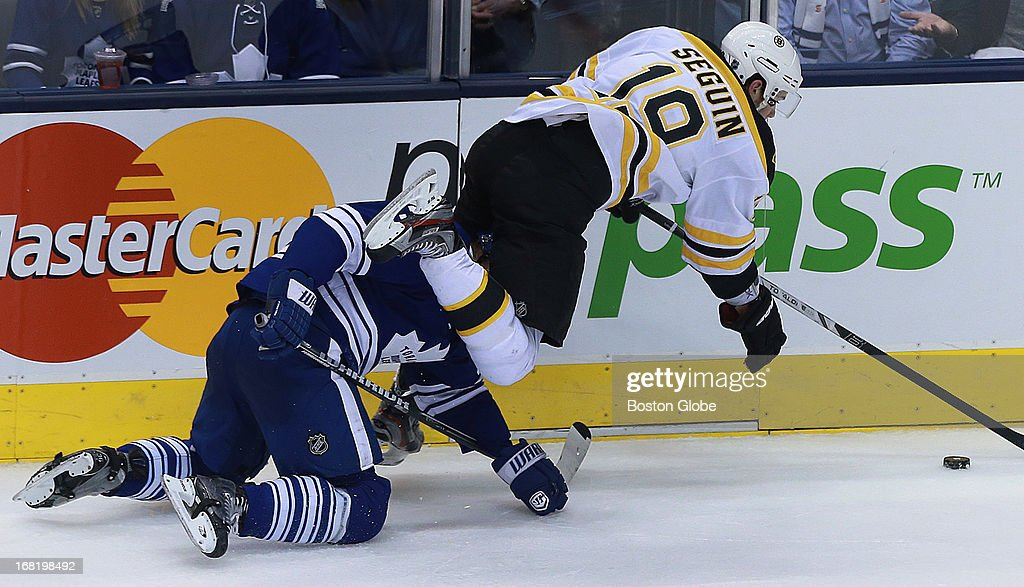 The Bruins Tyler Seguin takes the high road as he goes over the Leafs Carl Gunnarson as he chases a third period loose puck. The Boston Bruins visited the Toronto Maple Leafs for Game Three of the Stanley Cup Eastern Conference quarterfinal series at the Air Canada Centre.
