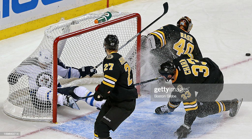 The Bruins' Zdeno Chara (#33) got a two minute penalty in the overtime period for this hit that sent the Jets' Blake Wheeler crashing into the crease, (and the net), but Boston killed off the penalty and eventually won the game in a shootout. Bruins goalie Tuukka Rask (#40) and defenseman Dougie Hamilton (#27) are also pictured. The Boston Bruins hosted the Winnipeg Jets in an NHL regular season game at the TD Garden.