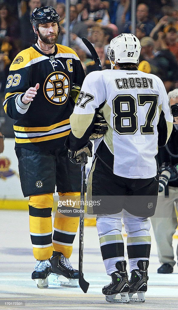 The Bruins Zdeno Chara, left, and the Penguins Sidney Crosby, right, start the traditional handshake line following the game. The Boston Bruins played the Pittsburgh Penguins in Game Four of the Eastern Conference Finals at TD Garden in Boston, June 7, 2013.