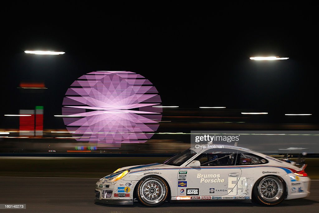 The #59 Brumos Racing Porsche GT3 Cup driven by Leh Keen, Andrew Davis, Marc Lieb and Bryan Sellers drives during the Rolex 24 at Daytona International Speedway on January 26, 2013 in Daytona Beach, Florida.