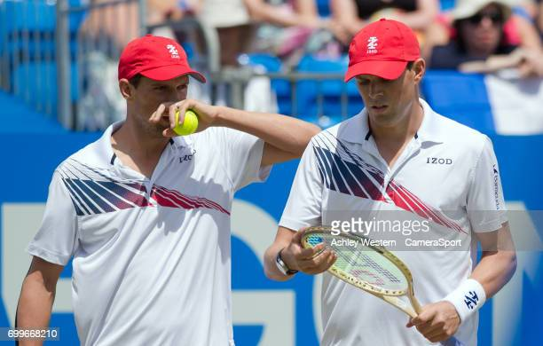 The Bryan Brothers in action against Julien Benneteau and Edouard RogerVasselin of France in their Mens Doubles Quarter Finals Match during Day 4 of...