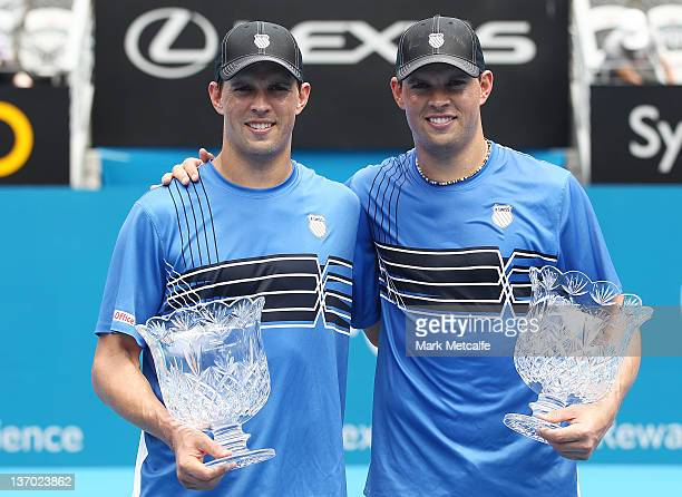 The Bryan brothers of the USA pose with the winners trophy after victory in the Men's Doubles final against Matthew Ebden of Australia and Jarkko...