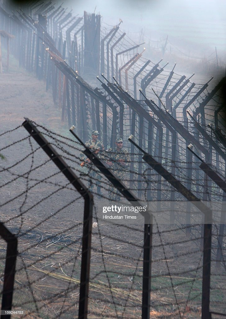 The BSF troops patrolling along with the border fence in the riverine area along the border with Pakistan in Ajnala sector on January 10, 2013 about 45 KMS from Amritsar, India. The situation between the two countries become tense after the Killing of two Indian soldiers by infiltrating Pakistani troops in Jammu and Kashmir.