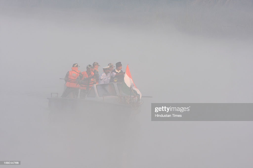 The BSF troops patrolling in dense fog on a boat in the riverine area along with border with Pakistan in Ajnala sector on January 10, 2013 about 45 KMS from Amritsar, India. The situation between the two countries become tense after the Killing of two Indian soldiers by infiltrating Pakistani troops in Jammu and Kashmir.