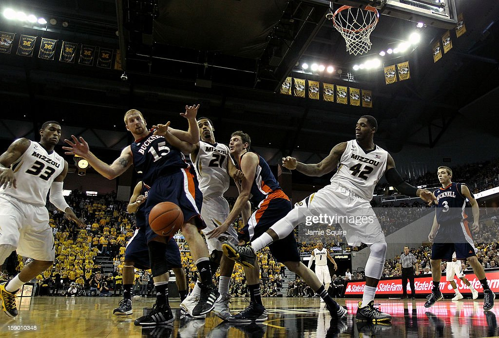the Bucknell Bison compete against the Missouri Tigers for a loose ball during the game at Mizzou Arena on January 5, 2013 in Columbia, Missouri.