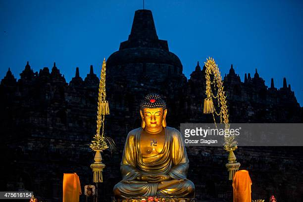 The Buddha statue at Borobudur temple is seen on Vesak Day on June 2 2015 in Magelang Indonesia Buddhists in Indonesia celebrate Vesak at the...