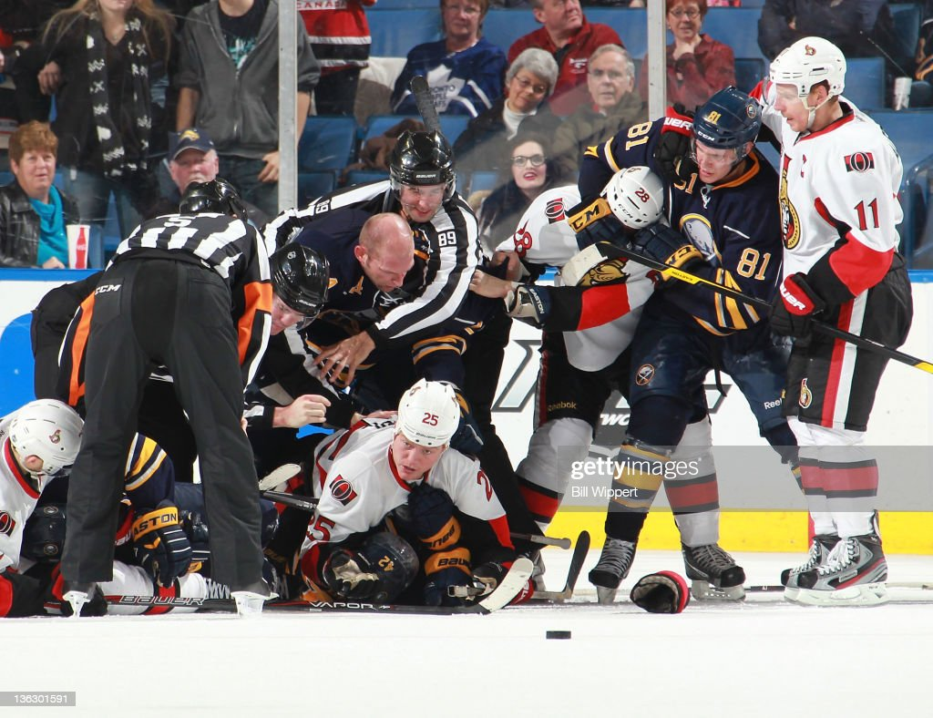 The Buffalo Sabres and Ottawa Senators have a wild scramble at the end of their overtime period at First Niagara Center on December 31, 2011 in Buffalo, New York. Ottawa defeated Buffalo, 3-2.