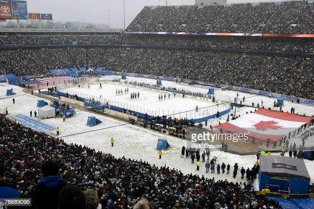 The Buffalo Sabres and Pittsburgh Penguins line up for the playing of the national anthems prior to the 2008 NHL Winter Classic on January 1 2008 at...