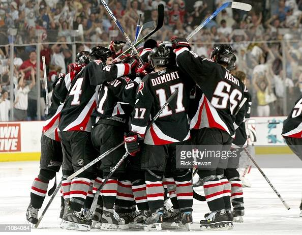 The Buffalo Sabres celebrate winning game six after a goal by Daniel Briere in overtime over the Carolina Hurricanes during the Eastern Conference...