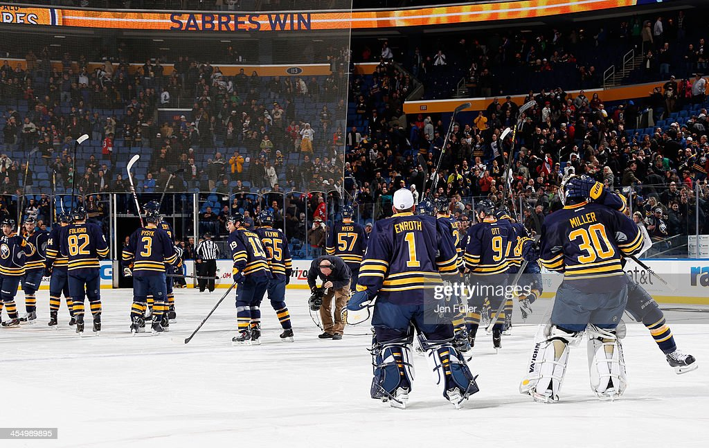 The Buffalo Sabres salute their fans as they celebrate a 2-1 shootout victory over the Ottawa Senators at First Niagara Center on December 10, 2013 in Buffalo, New York.