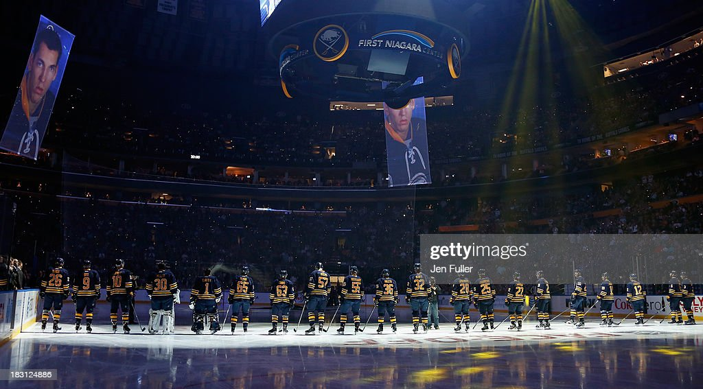 The Buffalo Sabres stand on the ice during a home opener ceremony prior to playing the Ottawa Senators at First Niagara Center on October 4, 2013 in Buffalo, New York.