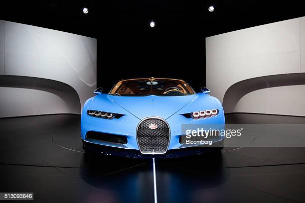 The Bugatti Chiron automobile produced by Volkswagen AG sits on display at a preshow unveiling event ahead of the 86th Geneva International Motor...