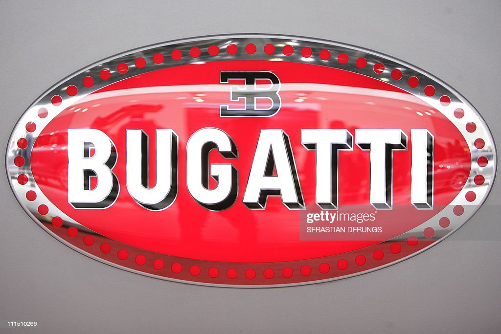 The Bugatti logo on show at the carmaker's booth on March 2 2011 during the preview day ahead of the opening of the Geneva Motor Show in Geneva The...