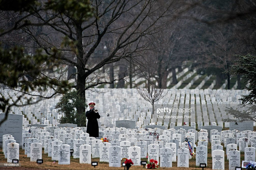 The bugler plays taps during the service for U.S. Army Sgt. Aaron X. Wittman at Arlington National Cemetery on Friday, February 8, 2013. 28, Sgt. Wittman was supporting Operation Enduring Freedom at the time of his death. He was the first combat KIA of 2013. Sgt. Wittman is from Chester, VA.