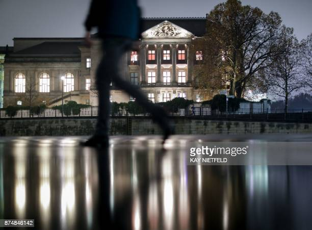 The building of the Deutsche Parlamentarische Gesellschaft in Berlin is illuminated on November 15 as further exploratory talks with members of...