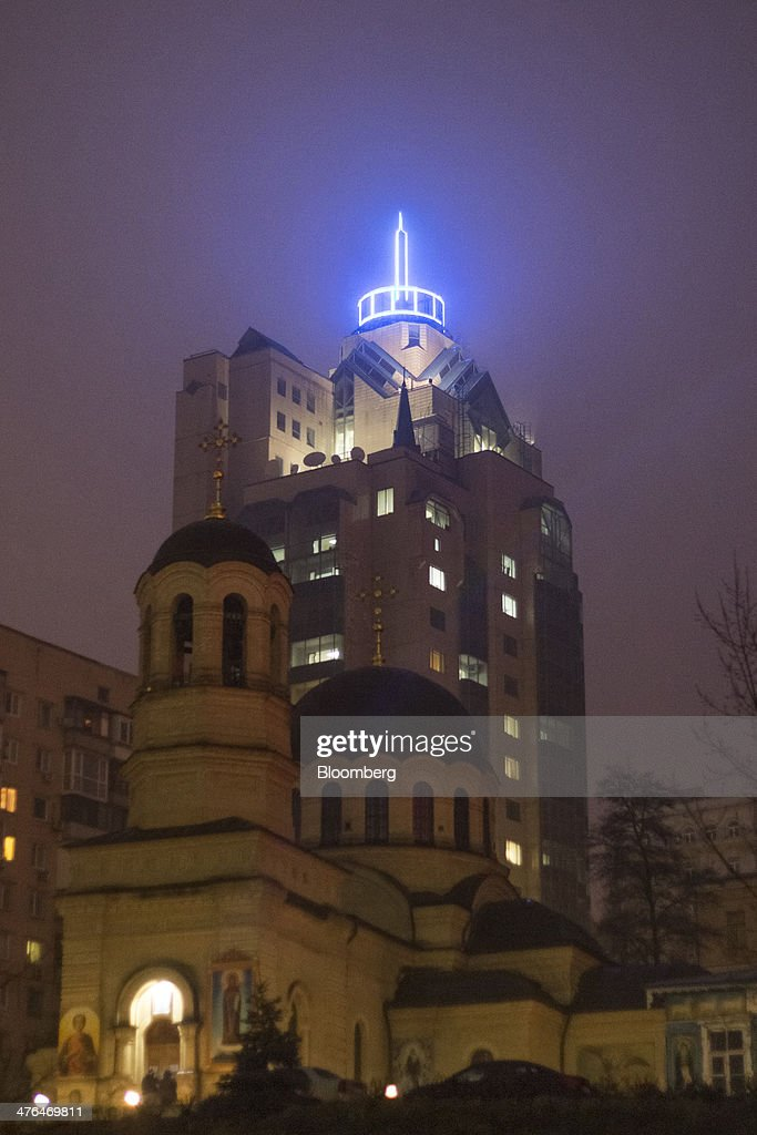 The building which houses the Ukraine Stock Exchange stands behind a church in Kiev, Ukraine, on Monday, March 3, 2014. Ukraine's Eurobonds slumped by the most on record as a Russian military incursion threatened efforts by the government in Kiev to obtain western economic aid and avert a debt default. Photographer: Vincent Mundy/Bloomberg via Getty Images