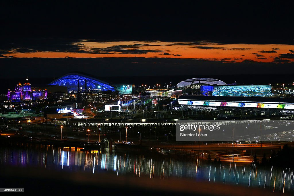 The buildings and stadia are lit up as the sun sets over the Olympic Park prior to the Sochi 2014 Winter Olympics on February 1, 2014 in Sochi, Russia.