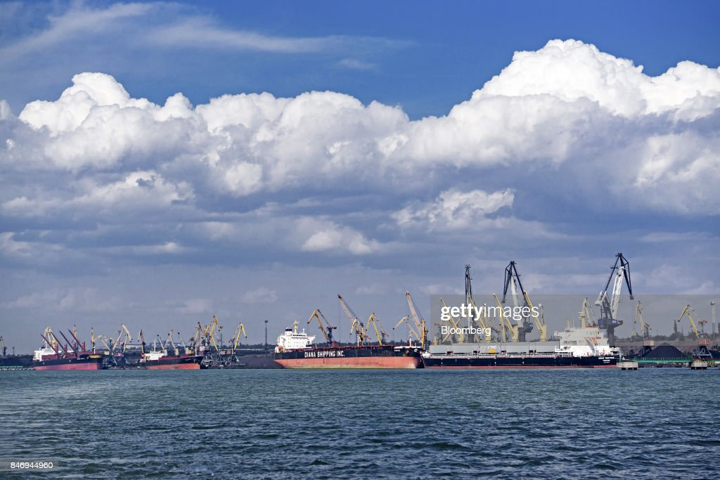 The bulk carrier 'Ocean Ambitious,' right, sits at the dockside as it delivers the first shipment of anthracite coal from U.S. supplier XCoal Energy & Resources LLC, for state energy firm Centrenergo PJSC, at Yuzhny Port, near Odessa, Ukraine, on Wednesday, Sept. 13, 2017. A Pennsylvania company will send 700,000 tons of coal to Ukraine in a deal the administration of PresidentDonald Trumpheralded as an important tool to undercut the power Russia has over its European neighbors. Photographer: Vincent Mundy/Bloomberg via Getty Images