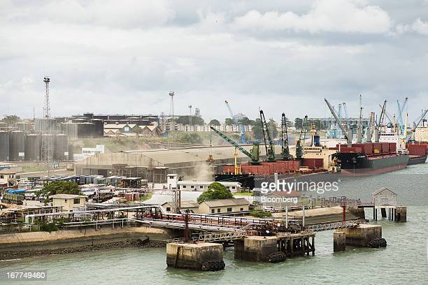 The bulk carrier ships the Fountain 5 left and the JS Mekong are seen moored alongside the dockside as their cargo is unloaded at Mombasa port...