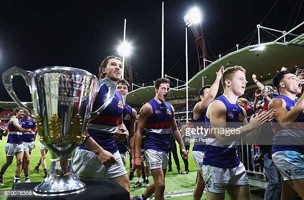 The Bulldogs celebrate victory after the AFL First Preliminary Final match between the Greater Western Sydney Giants and the Western Bulldogs at...