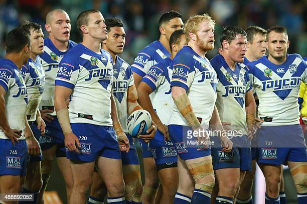 The Bulldogs look dejected after a Roosters try during the First NRL Semi Final match between the Sydney Roosters and the Canterbury Bulldogs at...