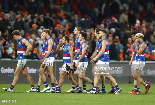 The Bulldogs look dejected after the round six AFL match between the Greater Western Sydney Giants and the Western Bulldogs at UNSW Canberra Oval on...