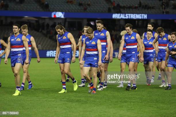 The Bulldogs walk from the ground after they were defeated by the Demons during the round 13 AFL match between the Western Bulldogs and the Melbourne...