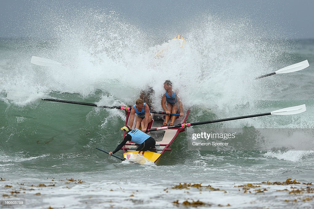 The Bulli suf life saving crew paddle through a wave during the Ocean Thunder Surf Boat Series at Dee Why Beach on February 2, 2013 in Sydney, Australia.