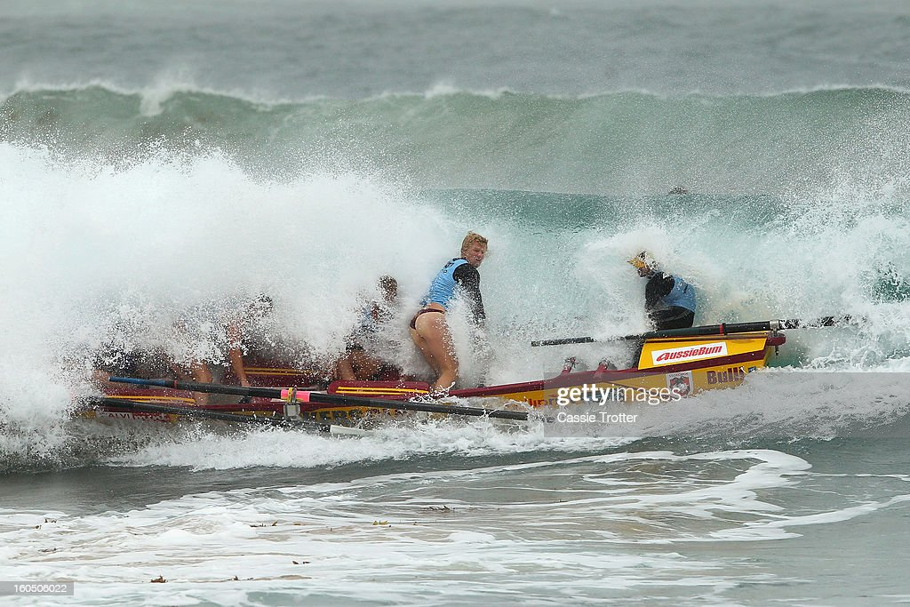 The Bulli surf life saving crew paddle through a wave during the Ocean Thunder Surf Boat Series at Dee Why Beach on February 2, 2013 in Sydney, Australia.