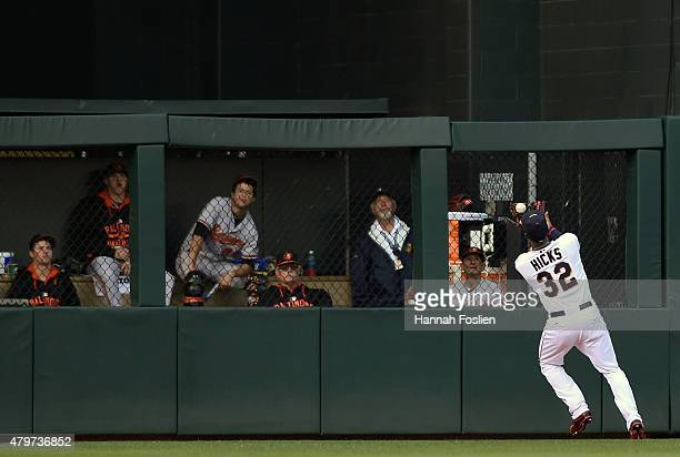 The bullpen of the Baltimore Orioles look on as Aaron Hicks of the Minnesota Twins makes a catch in center field of the ball hit by Chris Parmelee of...