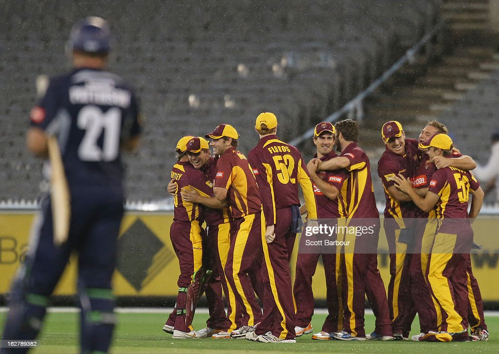 The Bulls celebrate after winning the Ryobi One Day Cup final as the Bushrangers batsman look on after the Ryobi One Day Cup final match between the Victorian Bushrangers and the Queensland Bulls at Melbourne Cricket Ground on February 27, 2013 in Melbourne, Australia.