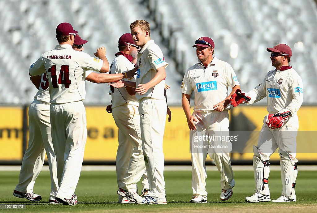 The Bulls celebrate the wicket of William Sheridan of the Bushrangers during day three of the Sheffield Shield match between the Victorian Bushrangers and Queensland Bulls at the Melbourne Cricket Ground on February 20, 2013 in Melbourne, Australia.