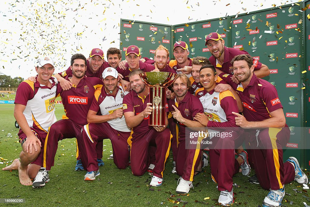 The Bulls team celebrate with the cup after victory during the Ryobi Cup Final match between the Queensland Bulls and the New South Wales Blues at North Sydney Oval on October 27, 2013 in Sydney, Australia.