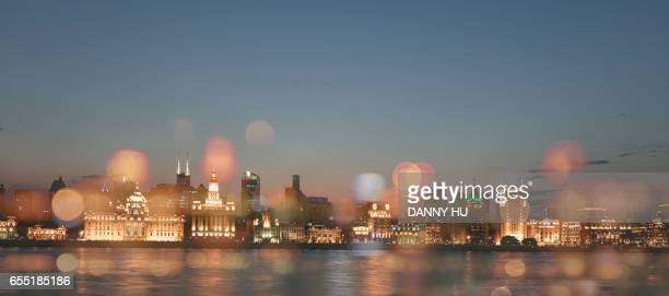 The bund of Shanghai was illuminated in the evening