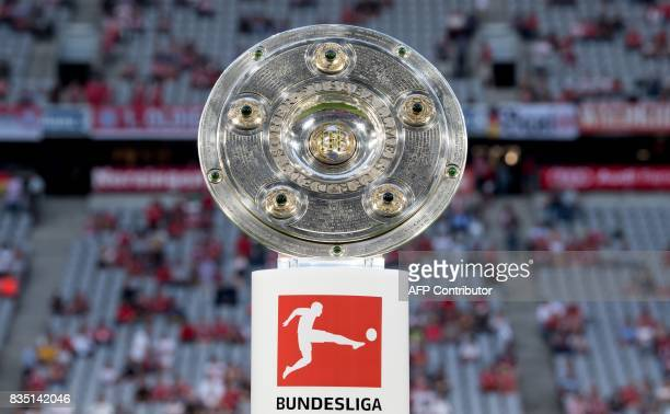 The Bundesliga trophy is on display prior to the German First division Bundesliga football match FC Bayern Munich vs Bayer 04 Leverkusen in Munich...