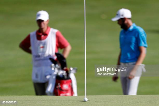 The bunker shot from Jordan Spieth of the United States settles inches from the cup on 15 during the third round of the Travelers Championship on...