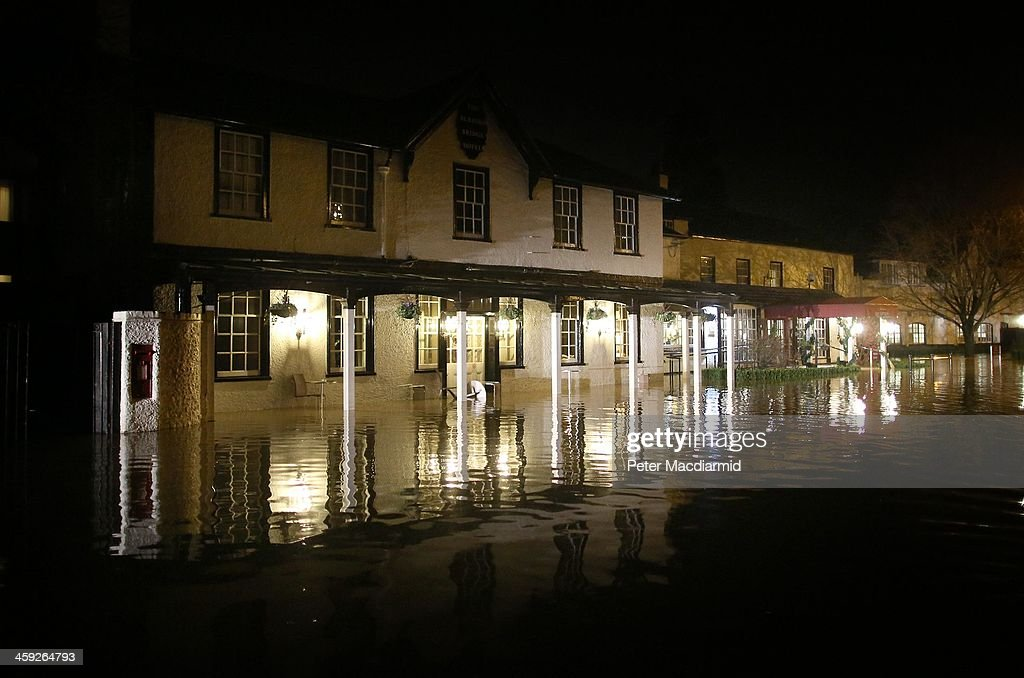 The Burford Bridge Hotel lies under floodwater from the River Mole on December 24, 2013 near Dorking, England. Christmas plans have been badly affected for thousands of people after storms across the UK have resulted in flooding, power cuts and significant problems with transport infrastructure.
