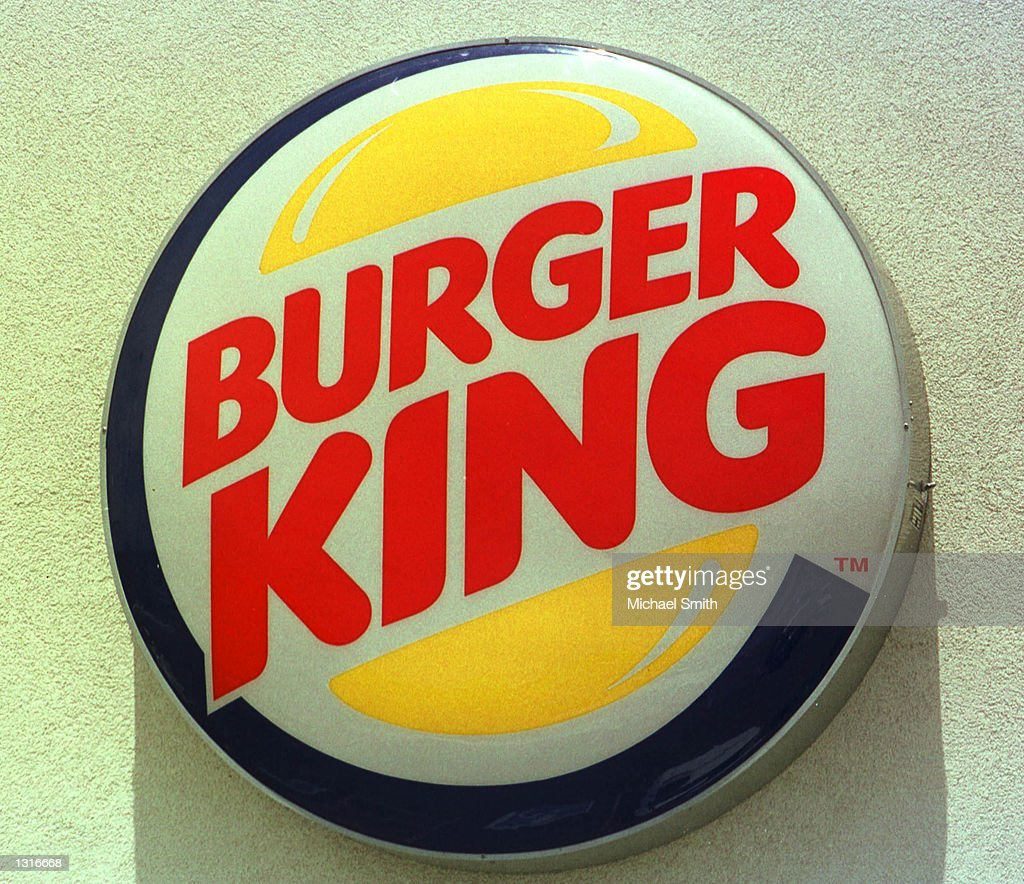 The Burger King logo hangs outside a Burger King restaurant June 12, 2001 in Federal Heights, Colorado. The fast-food chain has announced it will replace the netting at children''s play areas at its restaurants following the death of a four-year-old boy who died after becoming entangled in the netting at a Burger King restaurant in St. Louis.