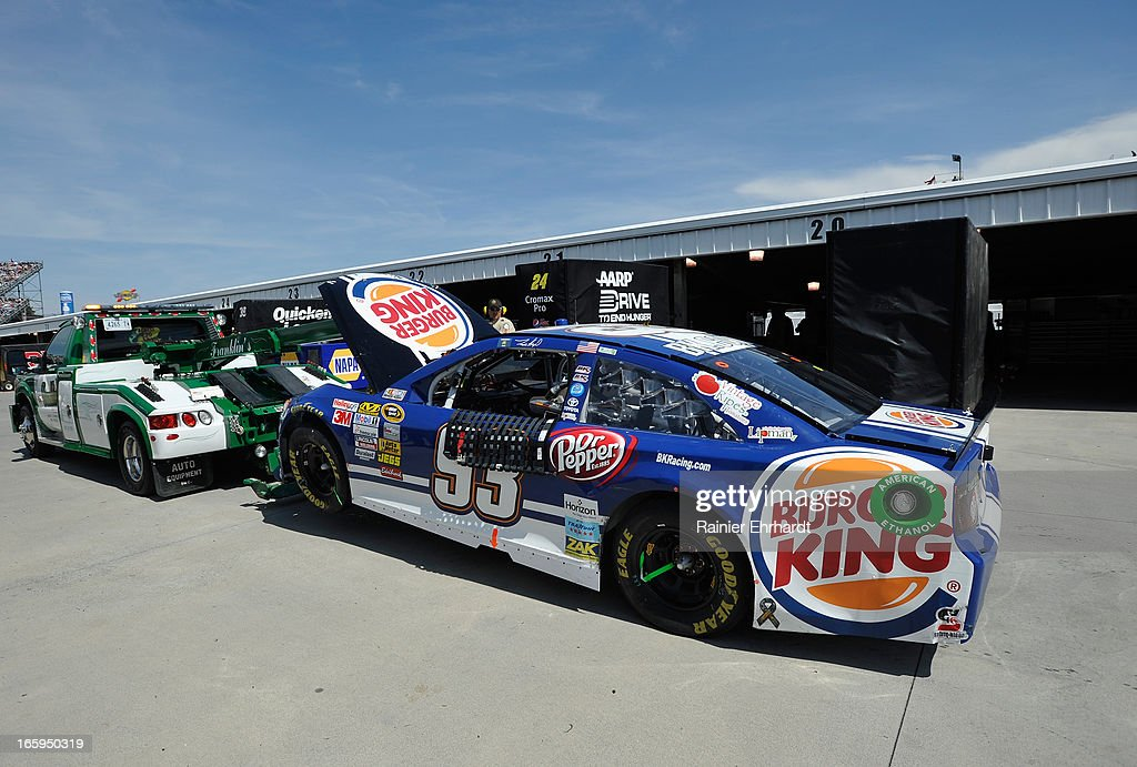 The #93 Burger King/Dr. Pepper Toyota is towed back to the garage area after an incident during the NASCAR Sprint Cup Series STP Gas Booster 500 on April 7, 2013 at Martinsville Speedway in Ridgeway, Virginia.