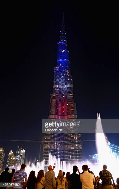 The Burj Khalifa is illuminated in the colours of the French flag on November 15 2015 in Dubai United Arab Emirates At least 120 people have been...