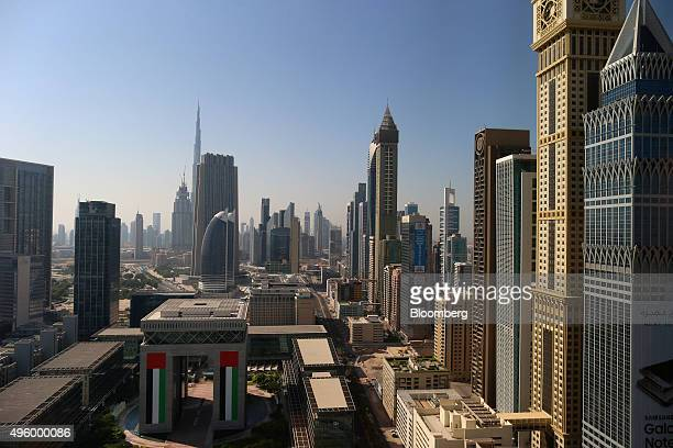 The Burj Khalifa tower center left stands above other commercial and residential skyscrapers beyond the Dubai International Financial Center...