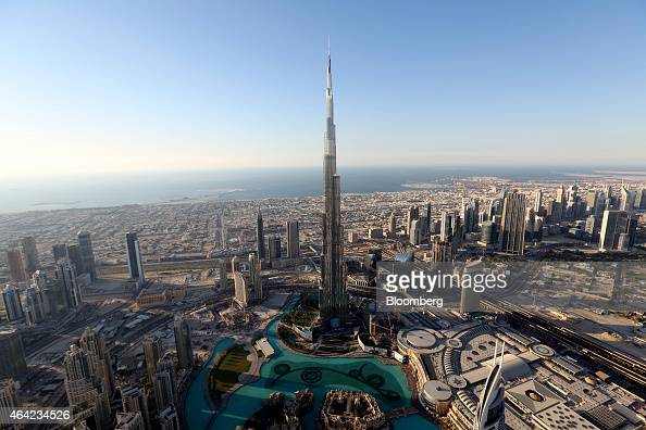 The Burj Khalifa tower center stands surrounded by other skyscrapers in this aerial view of the city skyline in Dubai United Arab Emirates on Tuesday...