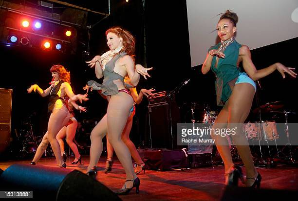 The burlesque group 'Harlow Gold' performs on stage during the 10th Annual GLAD Benefit in support of equal access for the deaf and hard of hearing...