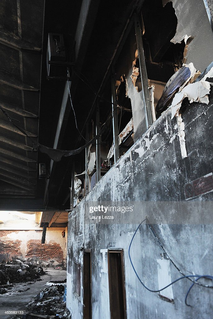 The burned interior of a clothing factory and the loft with an illegal dormitory is seen after a fire where seven Chinese workers were burned to death on December 4, 2013 in Prato, Italy. Seven people died and three were injured December 1, when a Chinese clothing factory in the industrial district of the Italian town of Prato in Tuscany burned, killing the workers trapped in a factory dormitory, where workers sleep, eat, and work.
