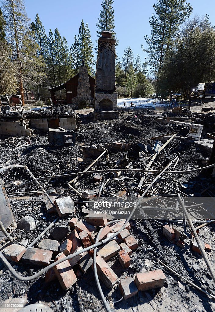 The burned out cabin where the remains of multiple murder suspect and former Los Angeles Police Department officer Christopher Dorner were found is seen on February 15, 2013 in Big Bear, California. Dorner, a former Los Angeles Police Department officer and Navy Reserve veteran, barricaded himself in the cabin near Big Bear, California, and engaged law enforcement officers in shootout, shooting two police, killing one and wounding the other. Dorner's, who's body was identified after being found, was wanted in connection with the deaths of an Irvine couple and a Riverside police officer.