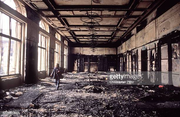 The burned out remains of Ceucescu palace in central Bucharest after the Romanian revolution succeeded in ousting from power the hated and feared...